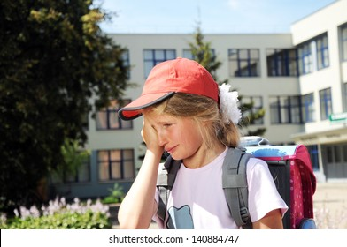 crying girl in front of the school
