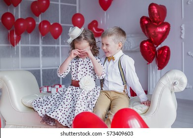 Crying girl and smiling boy. Valentine's Day concept.