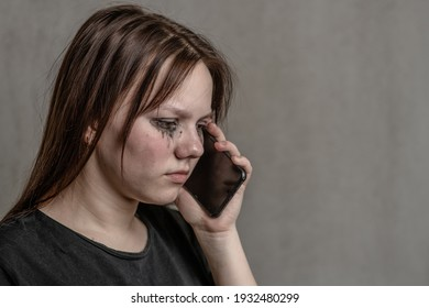 Crying girl talking to using a mobile phone