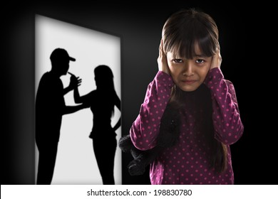 Crying illtle asian girl with her fighting parents in the background
