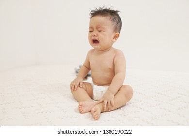 Crying little asian boy when he was left alone