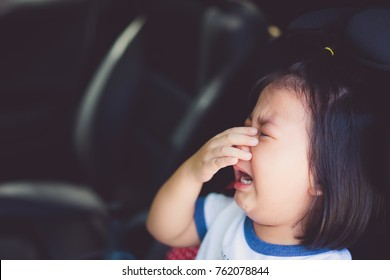 crying little girl on car seat in the car when she go to school in the morning.Little asian girl crying don't want go to school.