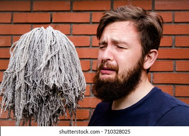crying man with broom