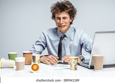 Crying man. Negative emotion facial expression feeling. Modern office man at working place, depression and crisis concept
