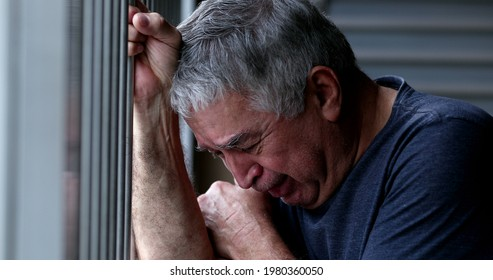 Crying older senior man. Depressed sad elder retired person