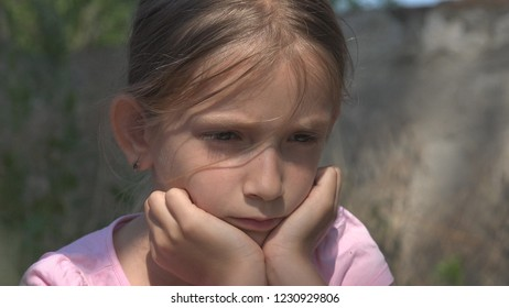 Crying Unhappy Child with Sad Memories, Stray Homeless Kid, Abandoned, Miserable