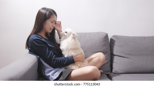 Crying woman being with her dog