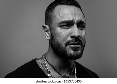 Crying wont help. Lonely single man. Hispanic guy feeling lonely and melancholy. Lonely man suffering from depression. Unhappy latino man crying over lonely life.