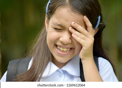 Crying Young Asian Girl Student With Books