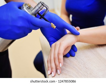 cryotherapy-cold treatment. A dermatologist examines a woman and holds a special device-a cryodestructor.effects on the human body by ultra-low temperatures