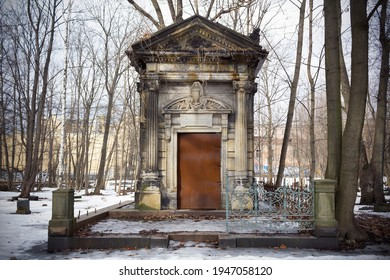 Crypt of Horwitz family, large stone tomb among snow and bare trees - Smolenskoe Lutheran Cemetery, Russia, Saint Petersburg, March 2021