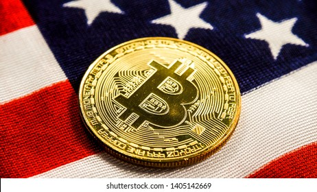 Crypto currency bitcoin btc golden bit coin against flag of United States of America USA. Virtual money, blockchain business, internet finances concept.