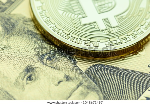 Crypto currency and bitcoin or digital money concept : Gold coin with B symbol and electronic circuit, US USD 20 dollar, Andrew Jackson. Bitcoin is popular, decentralized, limited, hard to control.