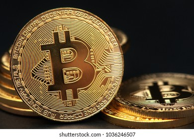 crypto currency bitcoin golden representation on black background
