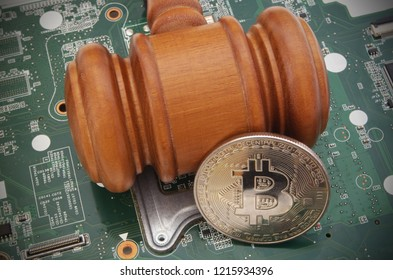 Crypto currency and bitcoin law concept, judge gavel and bitcoin symbol on computer circuite board