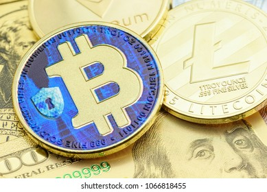 Crypto currency, blockchain / digital money concept : Gold coin, Bitcoin on US USD dollar notes, depicts risk in trading / investing or gambling virtual assets. BTC is open source, public platform.