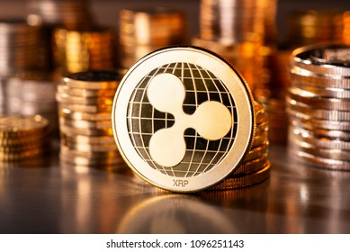 Crypto currency coin ripple with several stacks of coins in the background