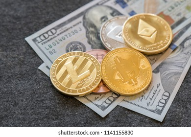 Crypto currency. Coins Bitcoin (BTC)and Ethereum (ETH) ,on background of banknotes one hundred dollars .Blockchain.Intarnational currency.Top view.E-commerce.E-business.Flat lay