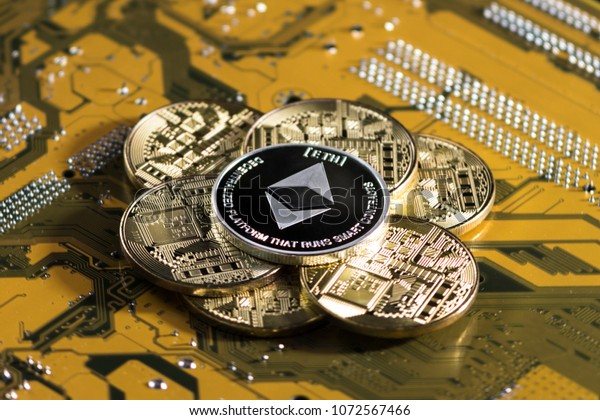 Crypto currency ethereum. ethereum coin on exchange charts. e-currency etherium on the background of the circuit board