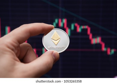 Crypto currency etherium. ethereum coin on exchange charts. e-currency etherium on the background of the schedule, arm,.