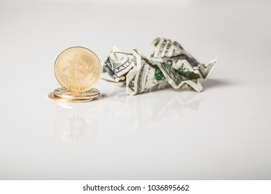 Crypto currency. Gold bitcoin coins and crumpled dollars on white background