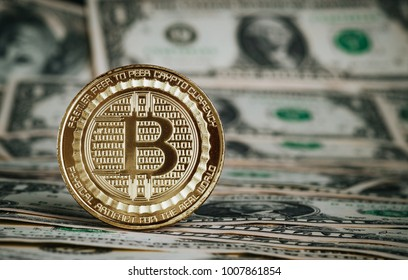 crypto currency gold bitcoin on dollar banknote background.Virtual digital money concept.financial business.