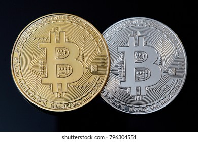 crypto currency. Gold and silver bitcoin on a black background. Electronic money. Bitcoin.