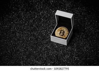 Crypto currency golden bitcoin coin in white gift box