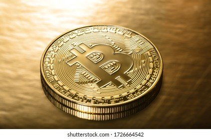 Crypto currency Golden Bitcoins on a gold background. Photo virtual money.Blockchain technology, bitcoin mining concept.