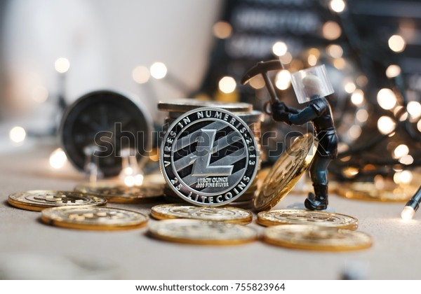 Crypto currency physical metal Litecoin coin. Christmas mining concept.