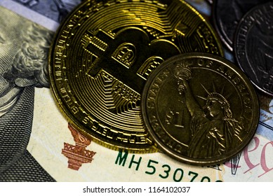 Crypto virtual currency Business finance concept, Close Up Shoot Of Golden Bitcoin and US dollar banknote & coins, Selective Focused. Electronic Money And Macro Finance Concept.