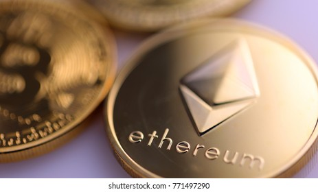 Cryptocurrencies on a purple surface.
