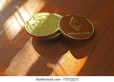 Cryptocurrencies on a wooden surface.