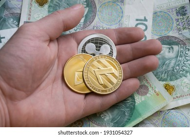 Cryptocurrency altcoins - ripple, ethereum, litecoin on polish money background.