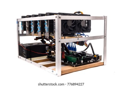 Cryptocurrency bitcoin ethereum altcoin graphic card miner mining rig. Home made crypto currency mining equipement in aluminium case with motherboard, graphic cards and PCIe powered extender risers.