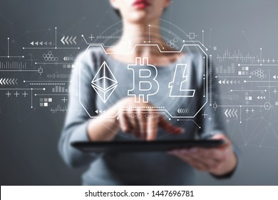 Cryptocurrency - Bitcoin, Ethereum, Litecoin with business woman using a tablet computer