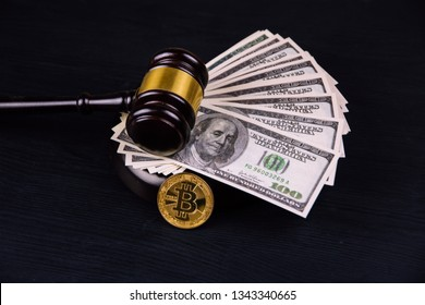 Cryptocurrency Bitcoin with gavel on a Dollar bills