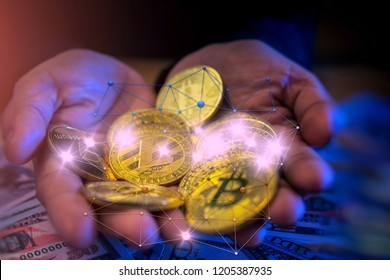 Cryptocurrency bitcoin , Litecoin (LTC) , Ethereum (ETH) and US dollars on hands close-up and line connection for business concept.