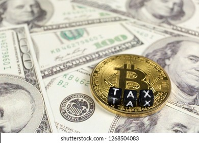 Cryptocurrency Bitcoin on a Dollar bills. Tax paying concept.