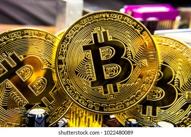 Cryptocurrency Bitcoin On The Motherboard. Gold Coin. Virtual Currency.