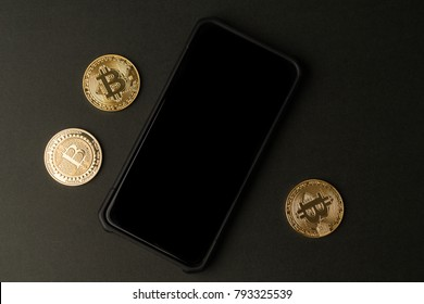 Cryptocurrency bitcoin and smart phone . Blockcain finch concept