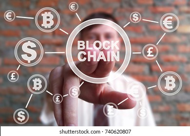 Cryptocurrency blockchain and bitcoin concept. Businessman presses currencies button block chain on  virtual electronic user interface.
