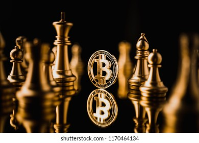 cryptocurrency business strategy ideas concept  bit coin with chess figure board game dark color tone