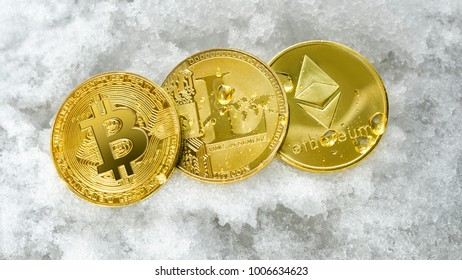 cryptocurrency coins - bitcoin (BTC), litecoin (LTC), ethereum (ETH); digital cryptocurrencys on snow