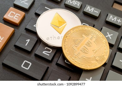 Cryptocurrency coins (Bitcoin and Ethereum) over calculator.