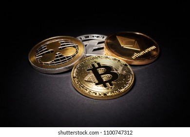 Cryptocurrency Coins: Bitcoin, Litecoin, Ethereum, Ripple on a black background. Business concept image.