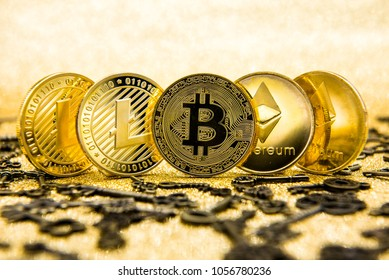 cryptocurrency coins - Litecoin, Bitcoin, Ethereum on gold background.