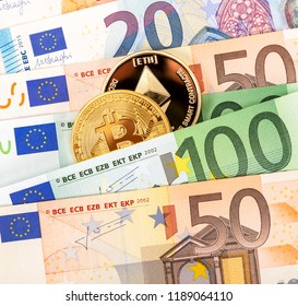 Cryptocurrency coins lying on the euro banknotes. Business concept of new virtual money