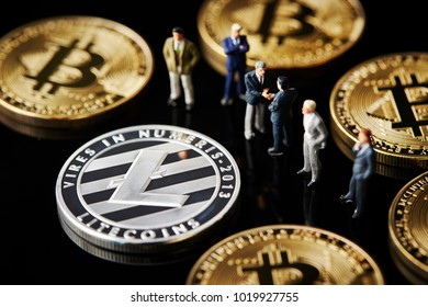 Cryptocurrency coins with miniature men