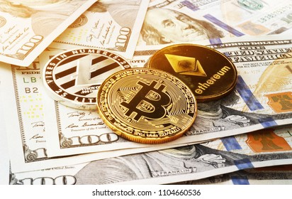Cryptocurrency coins on a dollar bills. Crypto exchange trading.